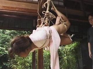 Outdoors restrain bondage gig of Asian..